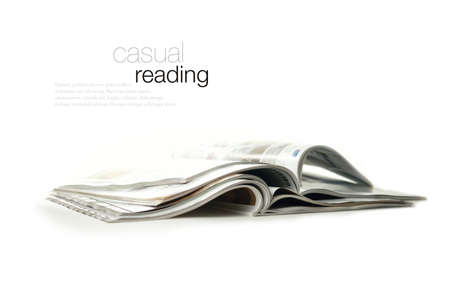 broadsheet: Conceptual image for marketing communications and advertising  High key studio image of glossy magazines against a white background with soft shadows  Copy space  Stock Photo