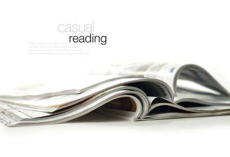 Conceptual image for marketing communications and advertising  High key studio image of glossy magazines against a white background with soft shadows  Copy space  Stock Photo