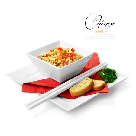 Studio shot of freshly prepared Chinese ribbon noodles with crisp breads. Selectively lit to create soft shadows against a white background. Copy space.
