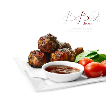 Tasty BBQ chicken legs with fresh salad against a white background  The perfect image for a summer party menu or BBQ invitation  Copy space