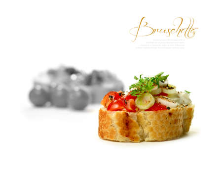 food buffet: Tomato, cream cheese and onion Bruschetta with mayonnaise against a white background  The perfect image for a restaurant or dinner invitation design  Copy space
