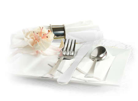 catering service: Formal dinner service as at a wedding or banquet. Stylish tableware against isolated white with white and pink single fuchsia. Copy space.