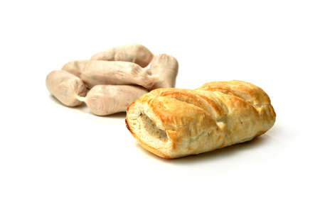 calories poor: Raw cocktail sausages and cooked sausage roll against a white background with soft shadows  Copy space