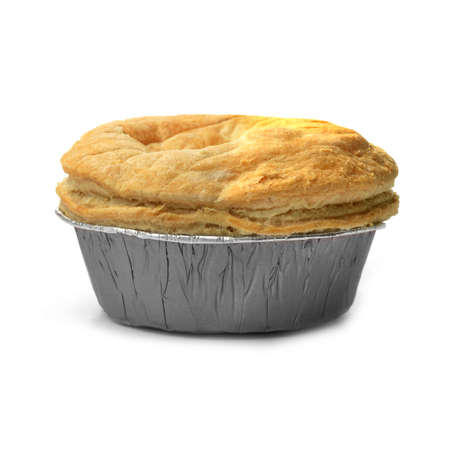 junk food: Isolated puff pastry meat pie with a foil base  Concept image for fast food, junk food or comfort food  Soft shadows against a white background  Copy space