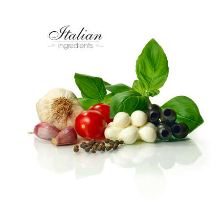 Bright and sharply focused selection of fresh Italian food ingredients against a white background. Copy space. Stock Photo
