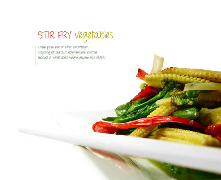 stir: Delicious freshly prepared stir fry vegetables against a white background with chop sticks. The perfect image for a restaurant menu cover or dinner invitation. Copy space.
