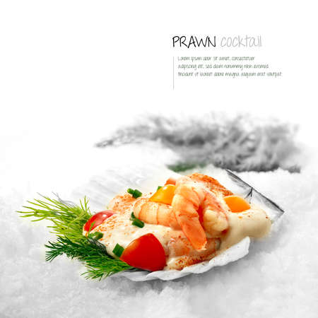 Freshly prepared classic Prawn Cocktail served in a scallop shell placed on white snow