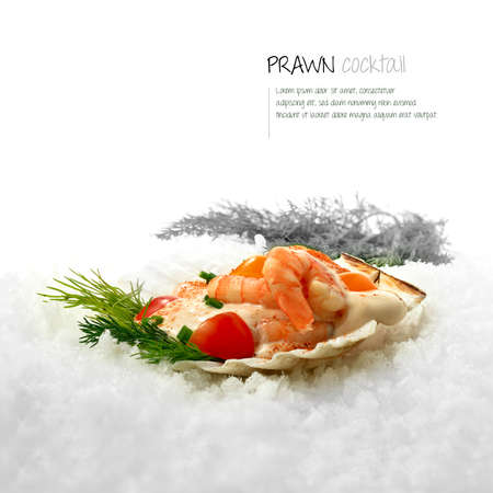 Freshly prepared classic Prawn Cocktail served in a scallop shell placed on white snow  photo