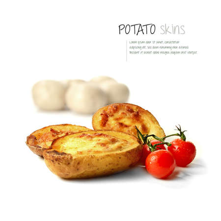 skins: Freshly grilled bacon and cheddar cheese potato skins with dew covered cherry tomatoes against white.  Stock Photo