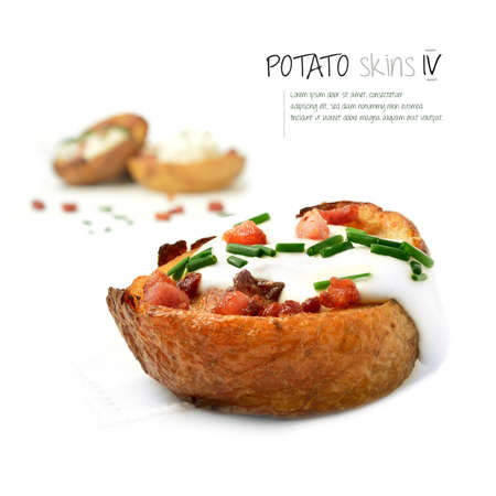 baked potato: Freshly grilled bacon and cheddar cheese potato skins ozzing with soured cream against white. The perfect image for a bistro or restaurant menu and advertisement. Copy space.