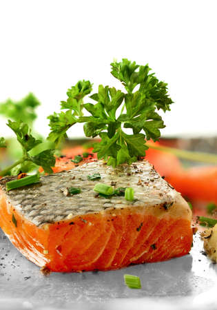 Fresh salmon fillet with garnish and cracked black pepper. Copy space. photo