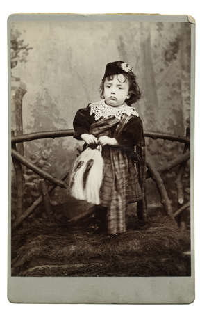 High resolution scan of a genuine vintage photograph circa 1893-1900 of young boy in traditional Scottish costume with kilt, horse-hair sporran and bonnet. photo