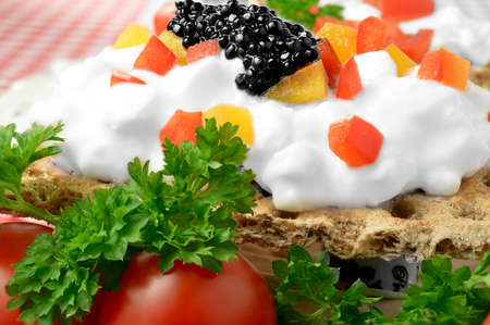 Bright macro of cream cheese canape with chopped peppers, parsley and tomatoes  photo