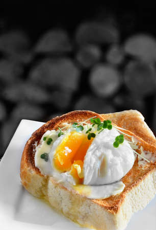 Poached egg on toast. A traditional English breakfast or snack. Image from my Pub Food Set. Copy space. Stock Photo