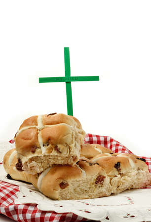 A seasonal Christian image related to Easter  Fresh home-made hot cross buns and a cross with embossed My Lord text  Copy space  photo