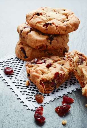 Freshly baked stacked cranberry and white chocolate chip cookies  Copy space  photo