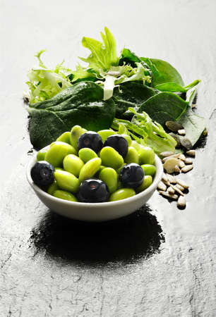 Super food salad  Edamame beans with blueberries and green leaf salad  Copy space  photo