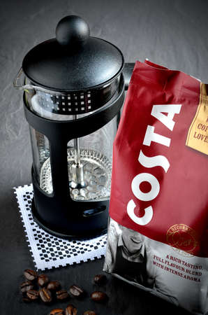 sergio: NOTTINGHAM, UK - MAY 2, 2014: Costa Coffee filter coffee foil pack with fresh coffee beans and cafetiere. Costa Coffee is a British coffeehouse company founded in 1971 by Italian brothers Sergio and Bruno Costa. Editorial