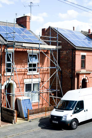 regenerative: NOTTINGHAM, UK - AUGUST 11, 2014: House with newly installed solar panels on roof - regenerative energy system electricity generation becoming more popular within the United Kingdom. Editorial