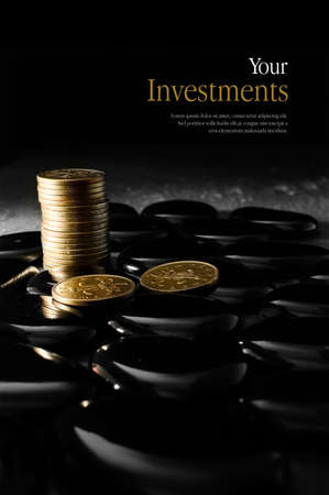 priceless: Concept image for pensions and investments. Creatively lit stacked currency coins symbolising investment. Copy space. Stock Photo
