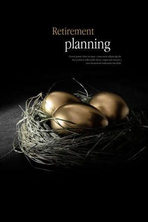 Concept image for retirement planning. Creatively lit golden goose eggs in a real birds nest representing client investments. Copy space.