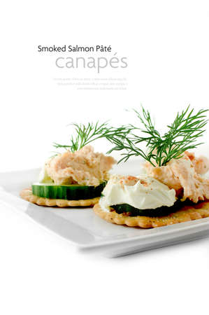 pate: Fresh salmon pate canapes with cream cheese and dill garnish against a white background. Copy space. Stock Photo