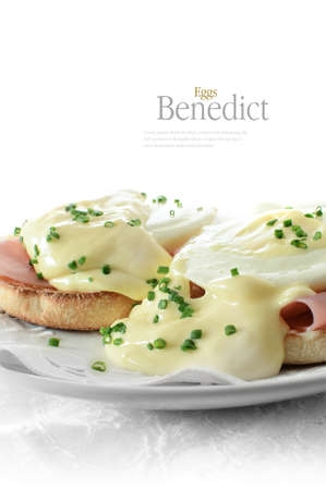 Fresh, delicious eggs benedict on warm muffins with Parma ham against a white background. Copy space. Standard-Bild