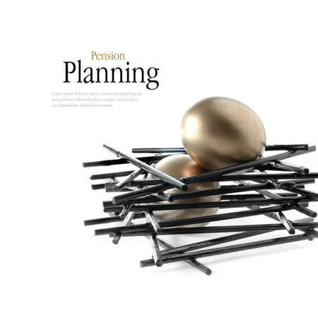 Golden goose eggs placed in a stark, black nest against a white background. Concept image for pension savings. Copy space. Stock Photo