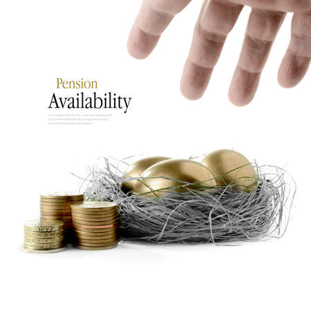 Golden goose eggs placed in a authentic looking grass nest against a white background with hand reaching. Concept image for pension savings and investments availability. Copy space. Banque d'images