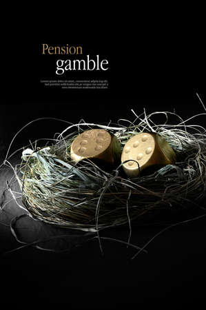 pensions: Concept image for pensions at risk. Creatively lit gold dice replacing gold eggs in a birds nest against black. Copy space.