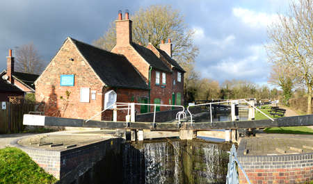 path cottage garden: NOTTINGHAM, UK - DECEMBER 25, 2014: Sandiacre Lock Cottages maintained by the Erewash Canal Preservation Development Association. United Kingdom.