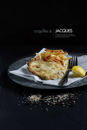 jacques: Classic Coquilles St. Jacques plated and styled with skinny fries and lemon garnish against a black background. Copy space.
