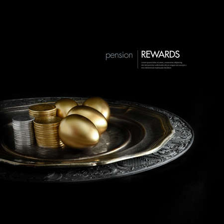 Concept image for pension rewards, returns or Investment funding. Creatively lit golden eggs and stacked coins on an antique pewter plate against a black background. Copy space. Banque d'images