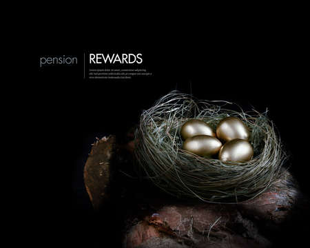 pensions: Creatively lit concept image for pension investments and financial planning. Gold eggs nestled in a real birds nest resting on dark wood against a dark background. Copy space.