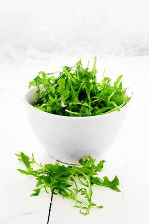 rukola: Fresh rocket salad leaf salad against a white, light, background. Concept image for healthy eating. Copy space.