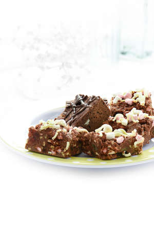 wedding favors: Delicious Rocky Road Belgium chocolate and marsh mellow chunks against white lace. Concept image for wedding favors or desserts. Copy space.