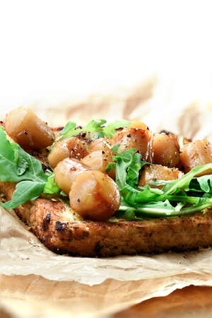 fine cuisine: Delicious seafood scallops, poached in white wine with a rocket leaf salad on granary sliced loaf. A culinary treat for any fine cuisine connoisseur. Accommodation for copy space.