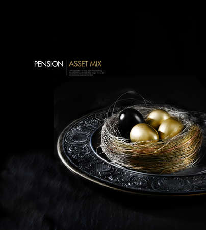 Concept image for financial asset management. Black egg amongst gold eggs, concept for mix, danger, risk, the unknown, bad news, imposter etc. Generous accommodation for copy space.