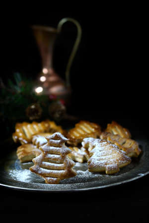 accommodation space: All butter festive biscuits against a dark background with creative lighting and generous accommodation for copy space.
