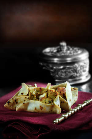 paneer: Paneer, aubergine and spiced chickpea open samosas against a rustic background with generous accommodation for copy space and selective focus.