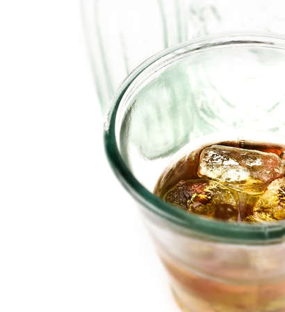 dui: Close up of whiskey on ice, also known as Scotch On The Rocks against a white background with generous accommodation for copy space. Concept image for DUI or drink driving. Stock Photo