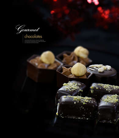 accommodation space: Luxury exotic dark chocolate liqueurs against a festive background. Ideal image for your Christmas, Valentines, Easter and Mothers Day designs. Generous accommodation for copy space. Stock Photo