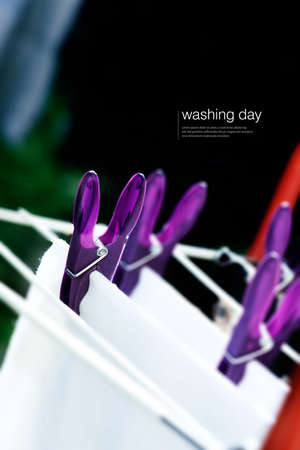 domestic chores: Concept image for housework, laundry, domestic chores etc. Colourful plastic clothes pegs with selective focus and generous accommodation for copy space. Stock Photo