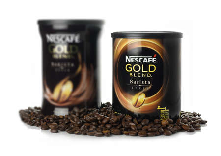 nestle: NOTTINGHAM, UNITED KINGDOM - MARCH 26, 2016: Nescafe Gold Blend Barista is a brand of instant coffee made by Nestle. Nestles flagship coffee product was first introduced in Switzerland on April 1, 1938.