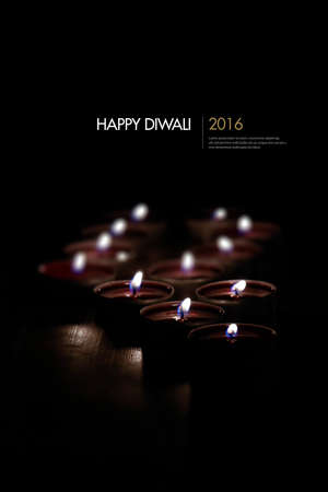 Quality image of numerous tee light candles shot against a black background providing generous accommodation for copy space. Concept image for religion, Diwali, peace, worship and remembrance.