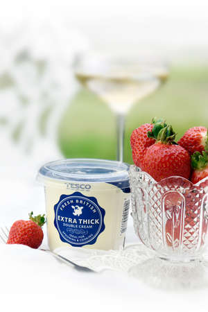 tonnes: NOTTINGHAM, UNITED KINGDOM - JULY 4, 2016: Tesco expect to sell 1,500 tonnes of strawberries during Wimbledon meaning that nearly 250 punnets are sold every minute.
