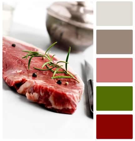 food hygiene: Raw uncooked sirloin beef steak prepared for cooking. Selective focus. Concept image for food preparation, hygiene and attention to detail. Copy space with complimentary colour swatch included. Stock Photo