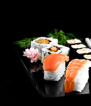accommodation space: Fresh Japanese sushi against a black background. Generous accommodation for copy space.
