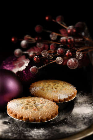 mincemeat: Festive mince pies against a dark background. the perfect image for your Christmas or Thanksgiving dessert menu cover design. Generous accommodation for copy space. Selective focus.