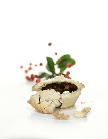 generosa: Festive Christmas mince pie against a light background with selective focus and generous accommodation for copy space with minimal composition with no clutter or distractions.